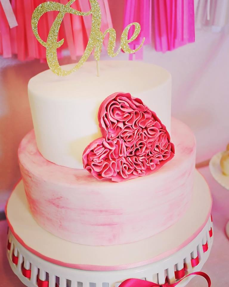 A Beautiful First Birthday Cake Simple And Stunning With Ruffled Heart Topped Gold Sparkle One Topper From Littleglitterco